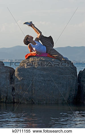 Stock Image of Woman at the edge of the sea k0711155.