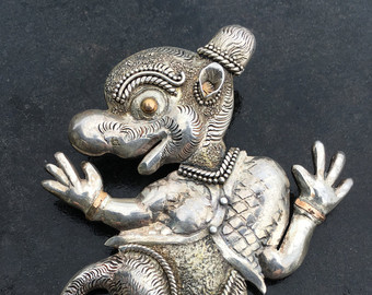 Silver repousse.