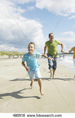 Pictures of Couple running with their son on beach, Egersund.
