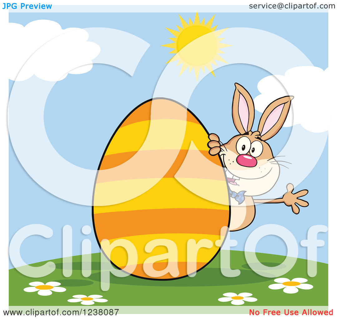 Clipart of a Brown Rabbit Waving on a Hill, with a Giant Orange.