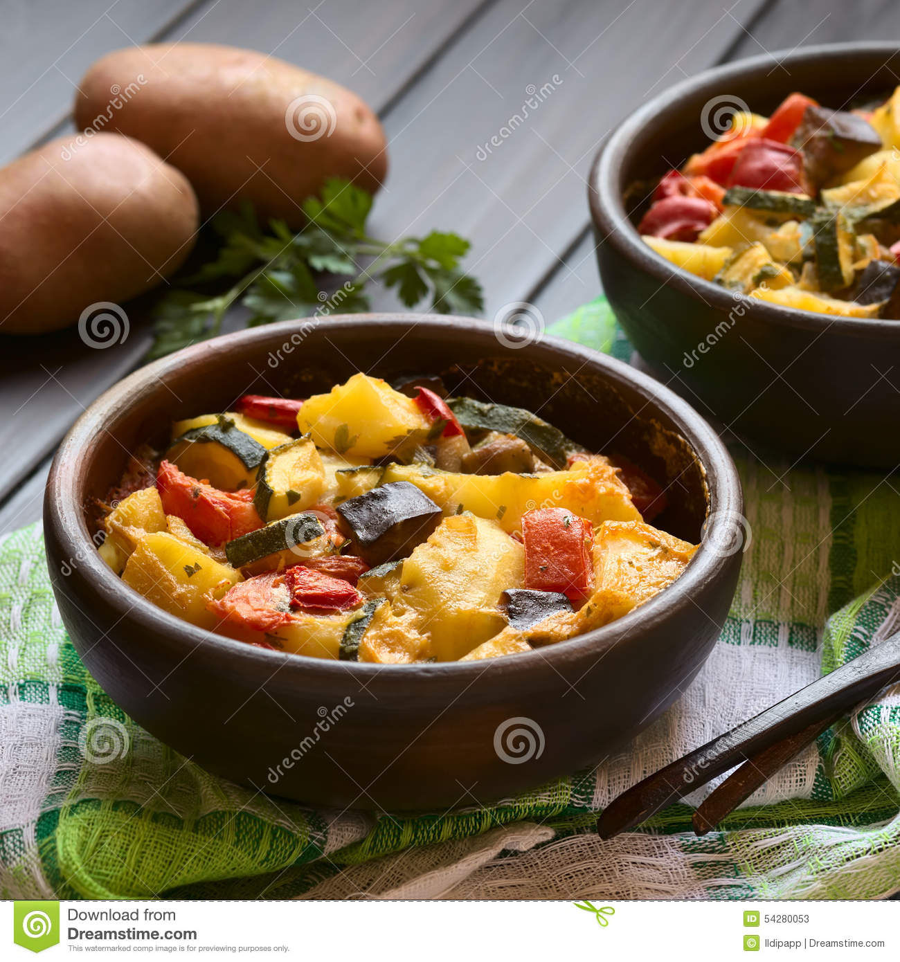 Baked Potato, Zucchini, Eggplant And Tomato Casserole Stock Photo.
