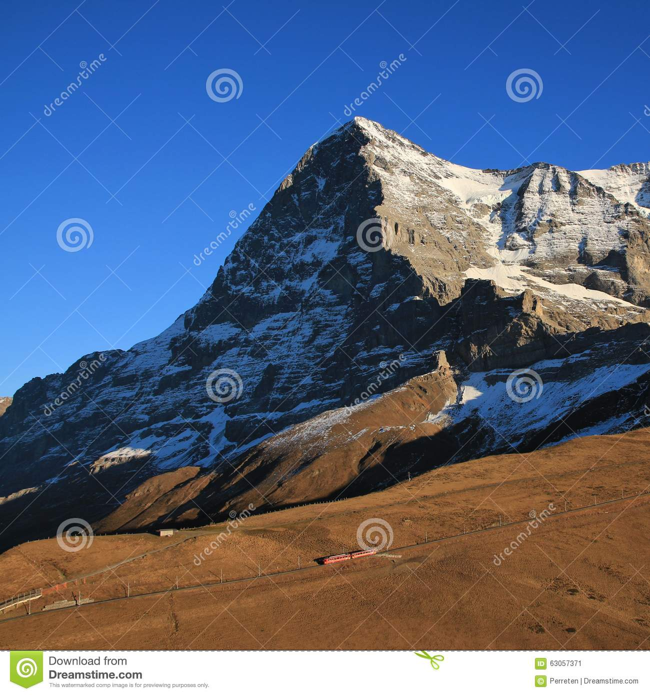 Eiger North Face And Train Stock Photo.