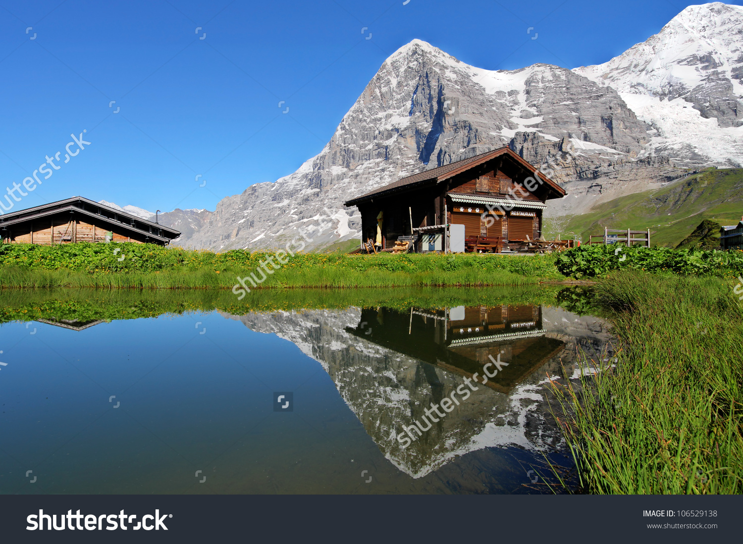 Swiss Mountain Chalet Reflecting Calm Pond Stock Photo 106529138.