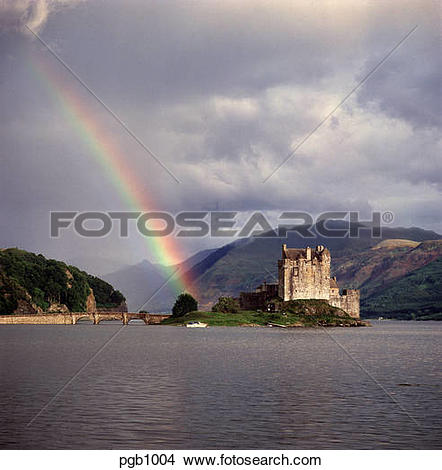 Stock Photo of Eilean Donan Castle situated on a sea lock with a.