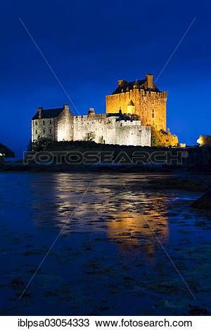 "Stock Photo of ""Eilean Donan Castle illuminated at dusk, Loch Alsh."