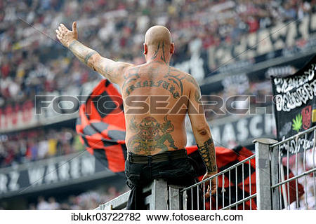 "Stock Photo of ""Tattooed Ultra fan of Eintracht Frankfurt sitting."