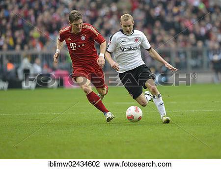 """Stock Photo of """"Duel between Bastian SCHWEINSTEIGER, FC Bayern."""