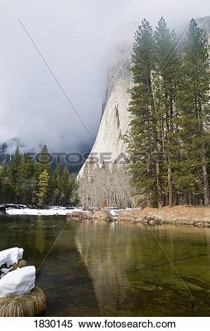 Stock Image of River at foot of mountain, El Capitan, Yosemite.