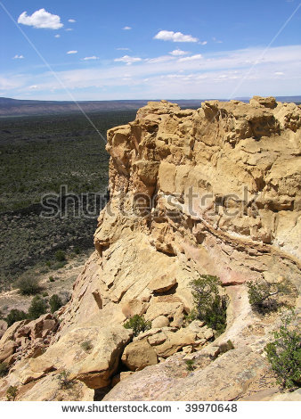 Sandstone Cliffs Green Desert Plants Overlooking Stock Photo.