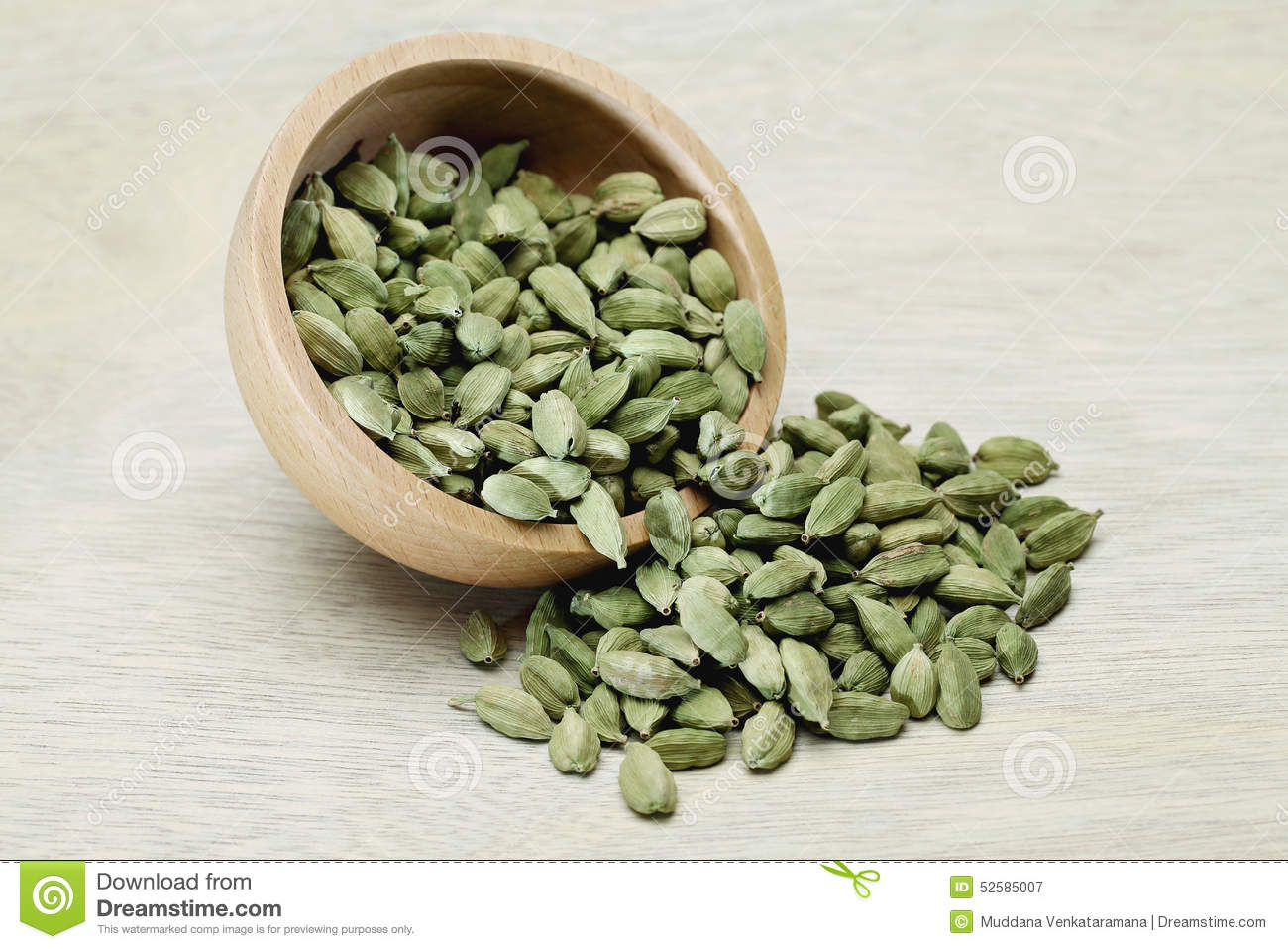 Cardamom Pods In A Wooden Bowl Stock Photo.