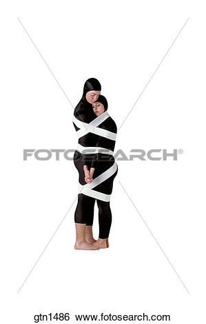 Stock Images of Silhouetted image of two modern dancers locked in.