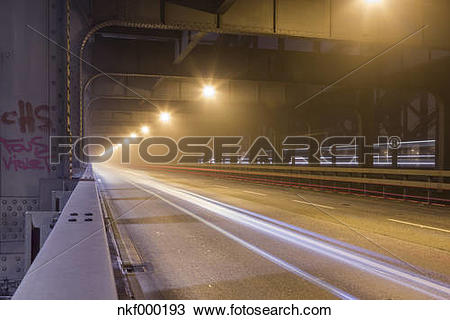 Stock Photo of Germany, Hamburg, historic Elbe bridge in dense fog.