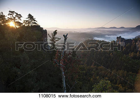 Stock Image of Sun rising on the Bastei, Elbe Sandstone Mountains.
