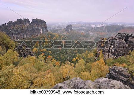 "Pictures of ""Schrammsteine in fog in autumn, in the Elbe."