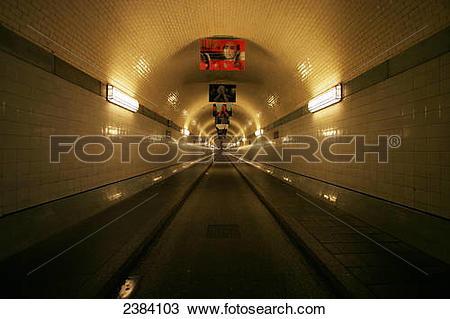 Stock Photo of Fluorescent lights lit up on wall in tunnel, Old.