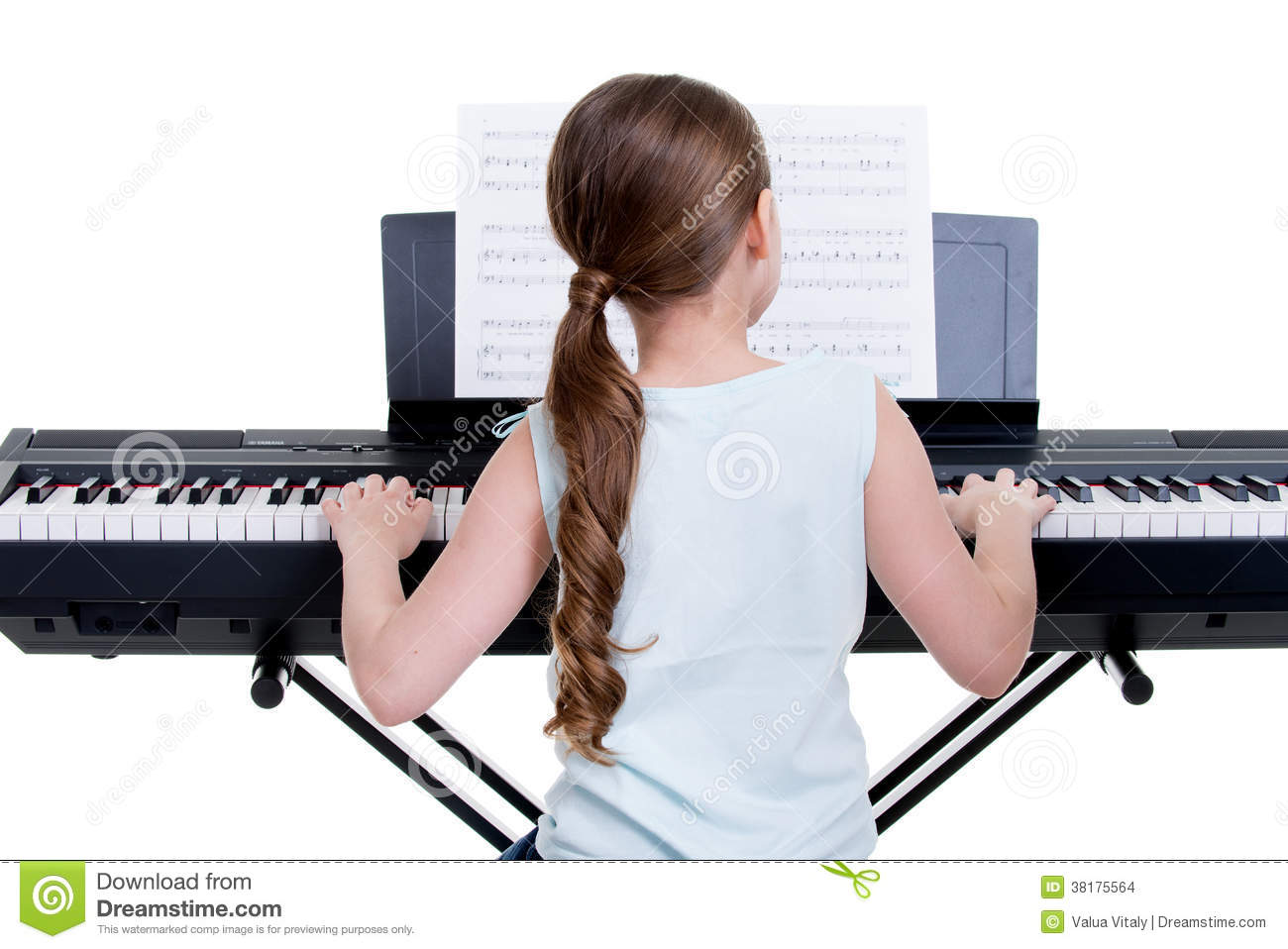 Back View Of Musician Sitting And Playing Piano Stock Images.