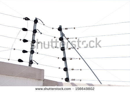 Isolated Electric Fence Installation On Boudary Wall. Stock Photo.