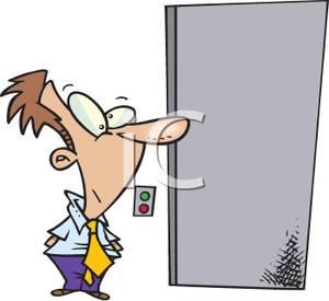 Cartoon of a Man Waiting For an Elevator.