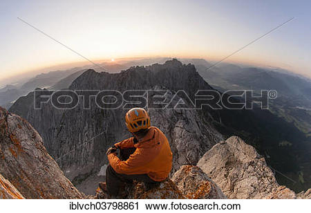 """Stock Photography of """"Climber sitting on the top of Ellmauer Halt."""