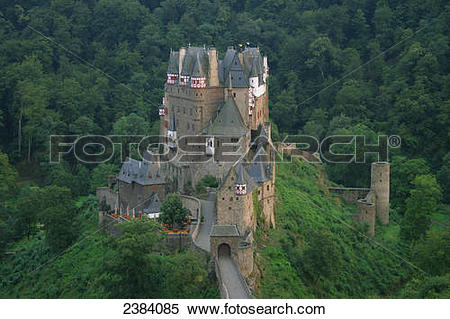 Stock Image of High angle view of castle surrounded by forest.