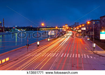 Stock Photography of lights from the headlights in motion blur.