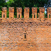 Stock Photo of Embrasure in the defense wall of red bricks.