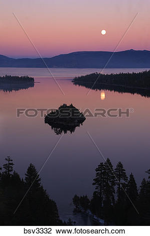 Stock Photo of The full moon rising over Emerald Bay at sunset.