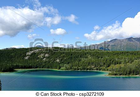 Stock Photographs of Emerald Lake, Sky, and Mountains, Yukon.