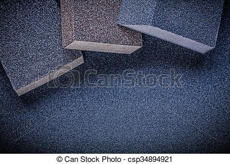 Stock Photo of Sanding sponges on emery paper abrasive tools.