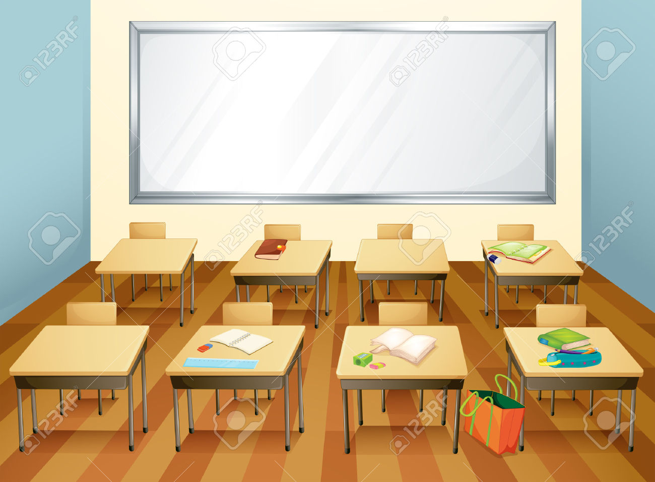 Empty Classroom With Stationary On The Desks Royalty Free Cliparts.