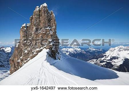Picture of A view of ski tracks and a rock formation on Mount.