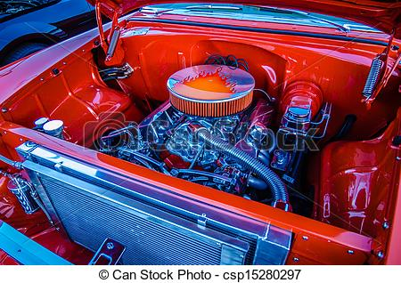 Stock Photographs of under the hood of a classic muscle car engine.