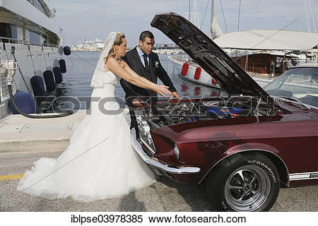 "Stock Image of ""Bride and groom looking into the engine."
