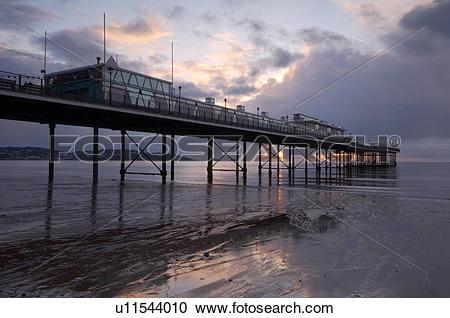 Stock Photography of England, Devon, Paignton, Sunrise over the.
