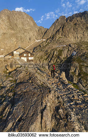 "Stock Photo of ""Hiker at Rifugio Pagari mountain hut, Parco."