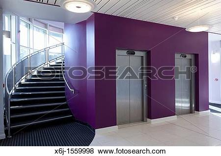 Pictures of Entrance foyer and curved stair case and lift doors of.