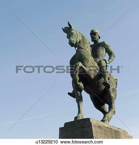 Stock Photography of Low angle view of an equestrian statue.