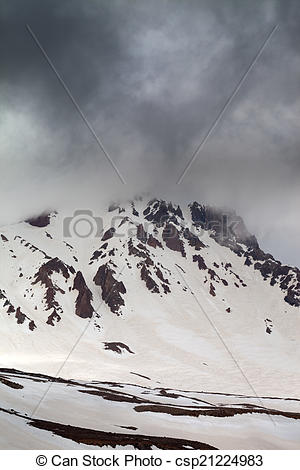 Pictures of Top of mountains in storm clouds. Mount Erciyes.