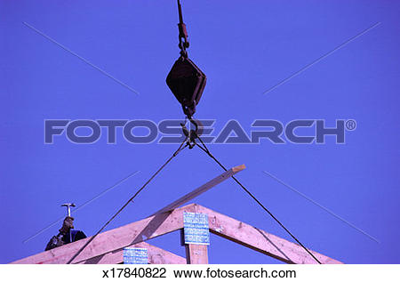 Stock Photo of Workers Erecting Roof Trusses x17840822.