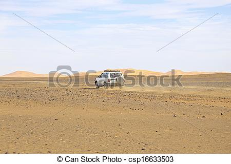 Stock Photography of Car driving in the Erg Chebbi desert in.