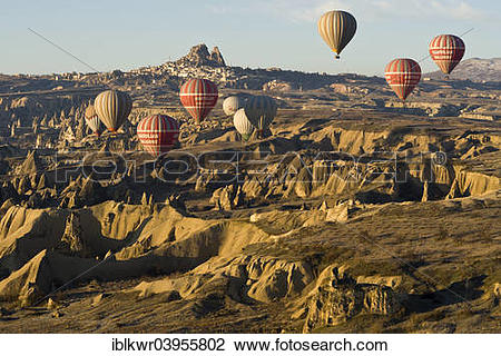 "Stock Photo of ""Hot air balloons in front of the Castle of Uchisar."