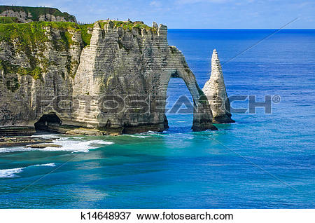 Picture of Etretat Aval cliff and rocks landmark and blue ocean.