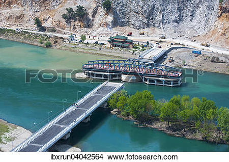 Stock Photo of Newly constructed swing bridge over Buna River.