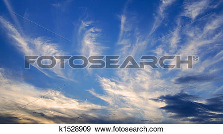 Stock Photograph of Evening clouds in deep blue sky k1528909.