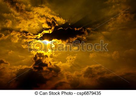 Stock Images of Summer orange evening sky with sun rays & clouds.