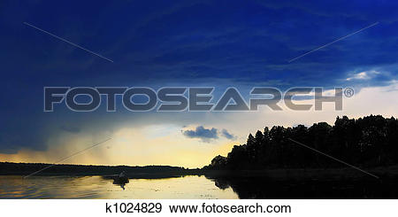 Stock Photograph of evening clouds roof k1024829.