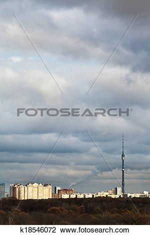 Stock Photo of evening clouds over houses and TV tower k18546072.