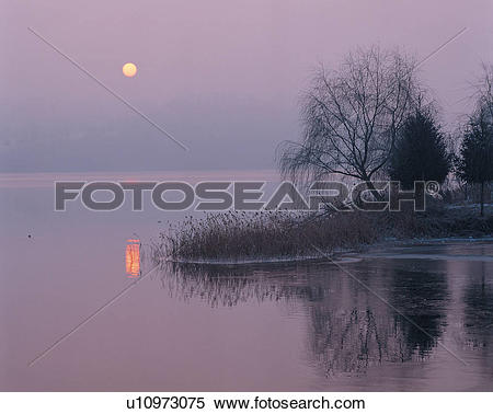Stock Image of scenery, lake, setting sun, evening glow, sunset.