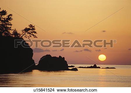 Stock Photo of Rock Mountain In Evening Glow u15841524.