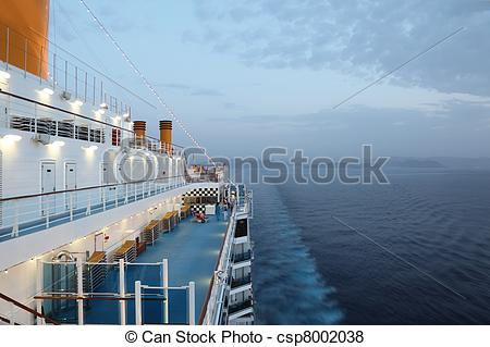Pictures of big cruise ship riding in evening. light on. few of.